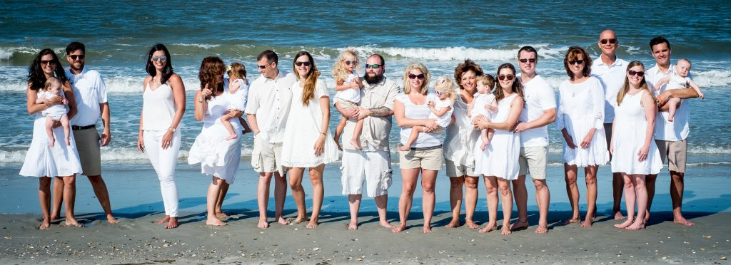 A family photo taken on the beach, at Holden Beach, NC.