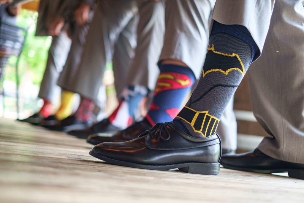 A detail photo of a groom and his groomsmen's special wedding socks. Photo taken by Pait Photography, at a wedding at the Cape Fear Winery and VIneyard, in Elizabethtown, NC.