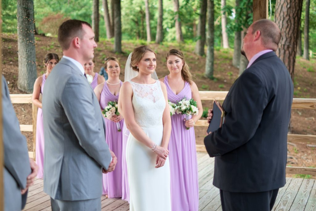 A photo of a bride  and groom during their wedding ceremony. Photo taken by Pait Photography, at a wedding at the Cape Fear Winery and VIneyard, in Elizabethtown, NC.