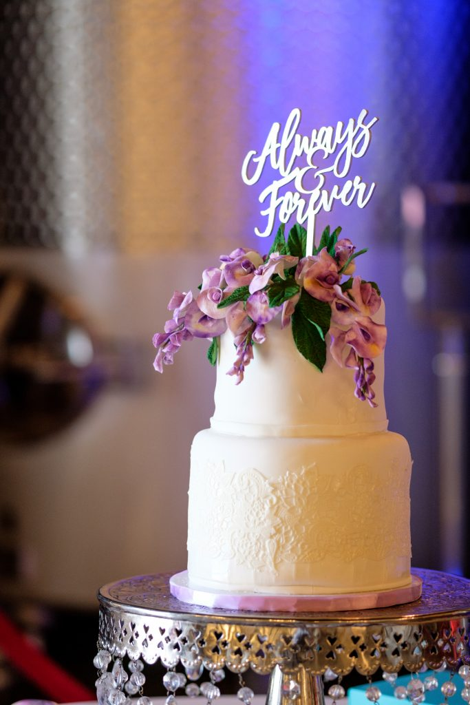 A photo of a wedding cake, inside of the reception area. Photo taken by Pait Photography, at a wedding at the Cape Fear Winery and VIneyard, in Elizabethtown, NC.