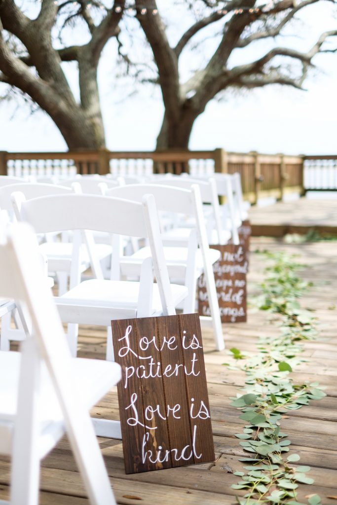 A photo of a wedding ceremony and signs at the Southport Community Center, in Southport, NC.