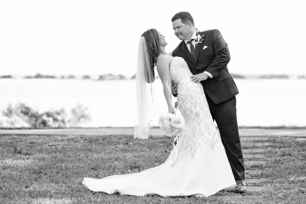 Black and white photo of a couple at their wedding. Photo taken by Pait Photography, at a wedding at the Southport Community Center, in Southport, NC.